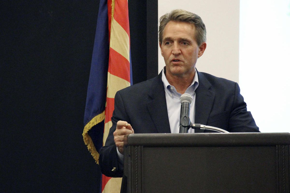 U.S. Sen. Jeff Flake addresses business officials gathered for an event in Prescott, Ariz., Thursday, Aug. 10, 2017. Flake told the group that that the new administration is restoring the balance on environmental regulations from what he called the one-si