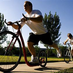 Ryan Spencer, left, and Dusty Terwilliger ride footbikes. The two, who work at Mountain Land Rehabilitation, say footbikes are great therapy.