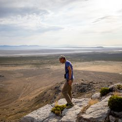 Hawkwatch International conservation science director Steve Slater watches as research associate Dustin Maloney rappels to a golden eagle nest in Tooele County on Friday, June 18, 2021.