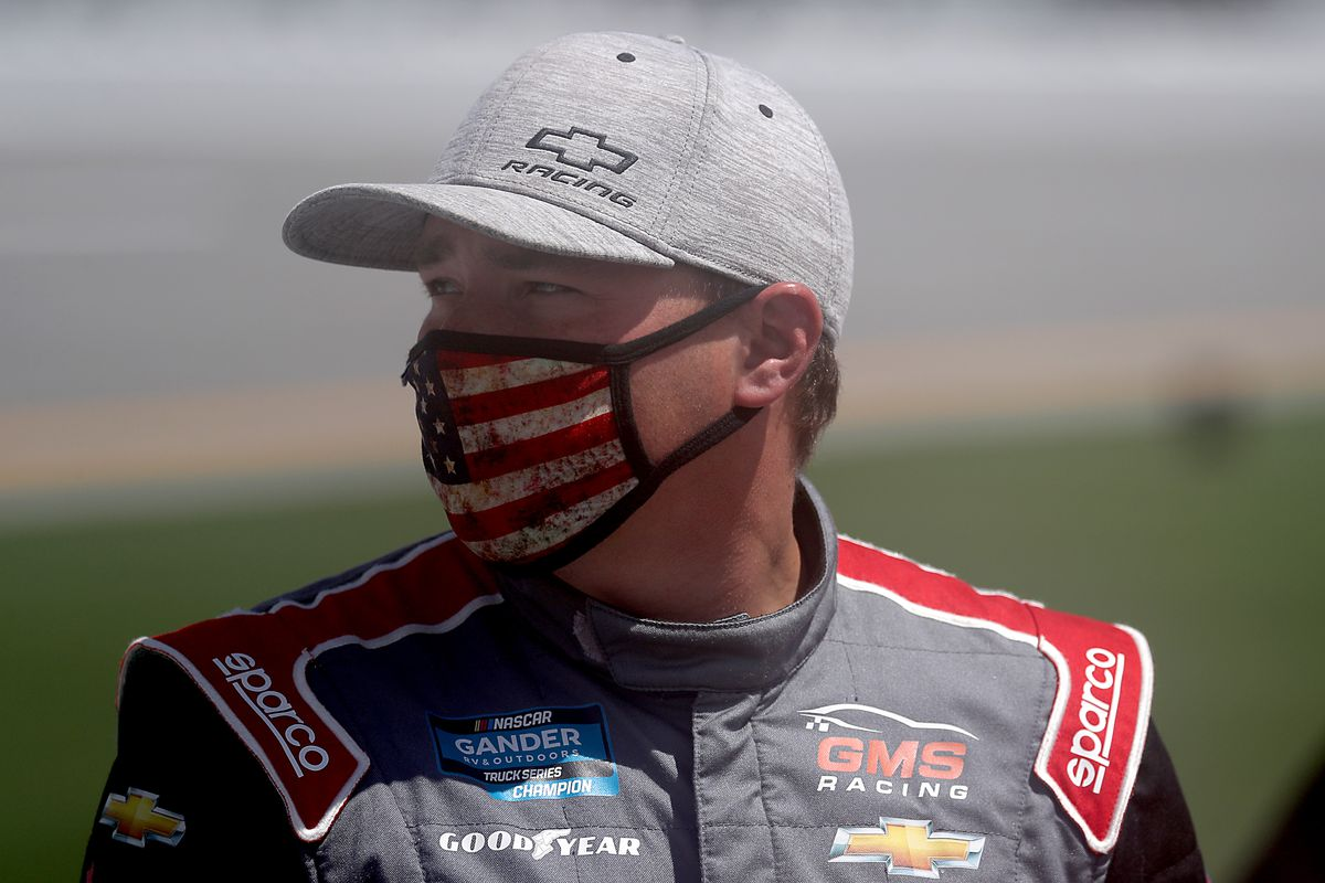 Brett Moffitt, driver of the CMR Roofing Chevrolet, waits on the grid prior to the NASCAR Gander RV & Outdoors Truck Series Sunoco 159 at Daytona International Speedway on August 16, 2020 in Daytona Beach, Florida.