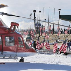 The Maverik Center in West Valley City is surrounded by helicopters, motorcycles, flags and blue ribbons for the funeral of Unified police officer Doug Barney on Monday, Jan. 25, 2016. Barney was killed in the line of duty on Jan. 17, 2016.