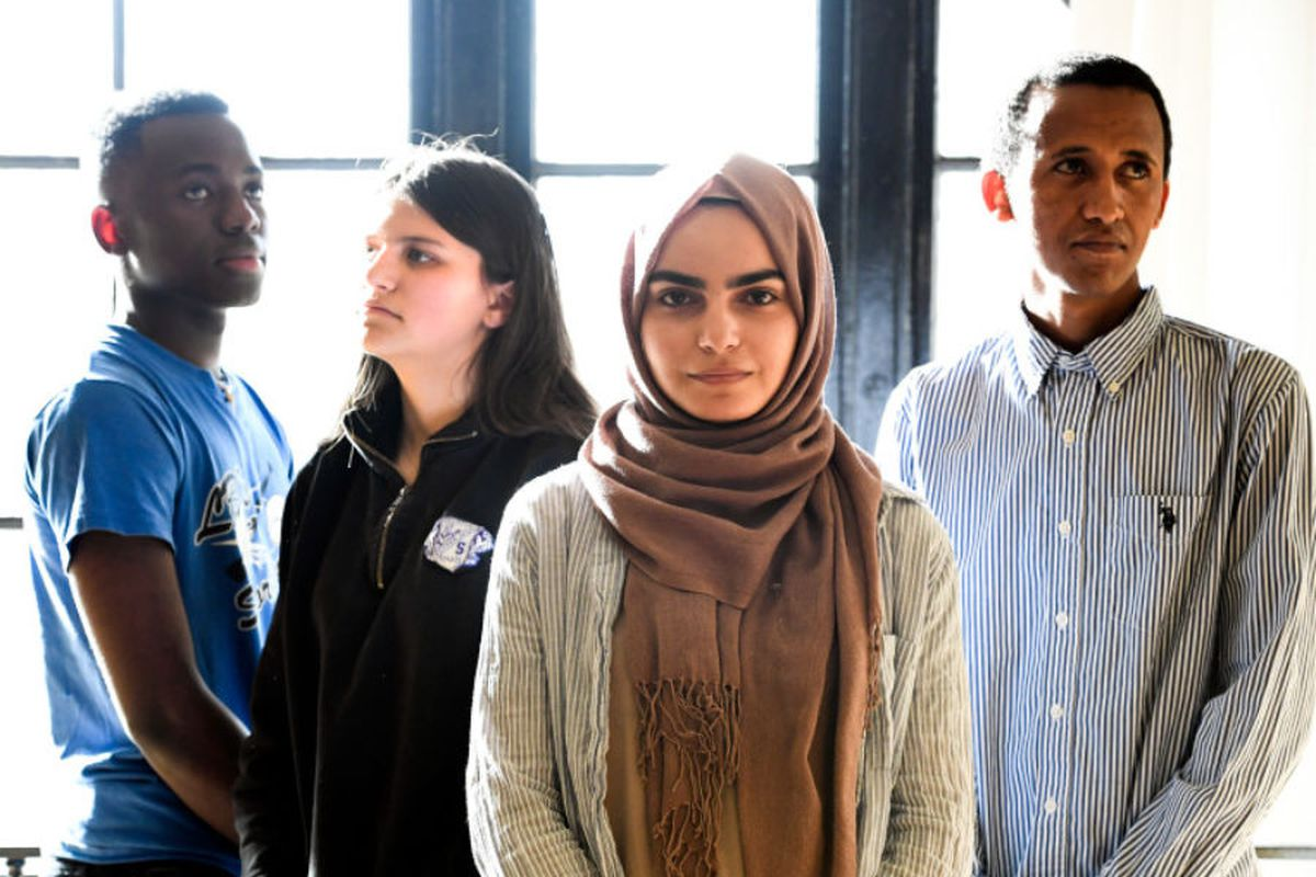 Refugee students pose for a portrait after an event at their school in Denver.