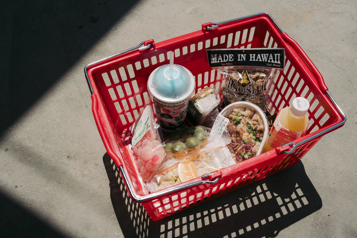 a basket of snacks and drinks.
