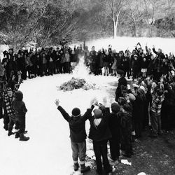 Youngsters at the Jenkins School, Scituate, Mass., on Dec. 22, 1948 appear cheerful enough as crime comic magazines go up in smoke on the school playground, touched off by firemen James Dacey (right center, inside circle). The bonfire climaxed a fifth-grade campaign against comic books with emphasis on crime stories.