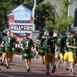 The Packers Tunda Line drum team performs during a parade in Canton
