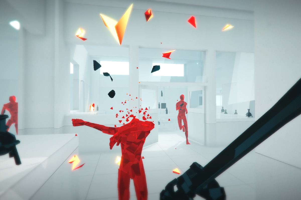 A red enemy loses his head to a melee weapon