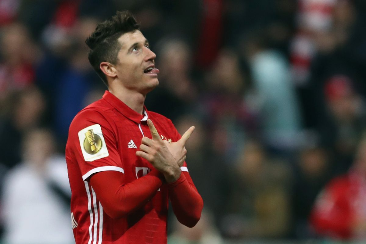MUNICH, GERMANY - MARCH 01: Robert Lewandowski of Muenchen celebrates his team's first goal during the DFB Cup quarter final between Bayern Muenchen and FC Schalke 04 at Allianz Arena on March 1, 2017 in Munich, Germany. (Photo by Lars Baron/Bongarts/Getty Images)