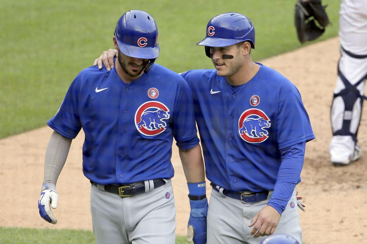 Kris Bryant of the Chicago Cubs talks with Anthony Rizzo of the Chicago Cubs after they scored against the Detroit Tigers on a home run hit by Matt Duffy at Comerica Park on May 15, 2021, in Detroit, Michigan.