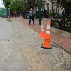 2:53 p.m. Gravel filling in the gap, where the curb used to be, along Sheffield -