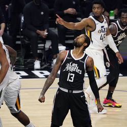 Los Angeles Clippers guard Paul George, center, poses after scoring during the second half in Game 6 of a second-round NBA basketball playoff series against the Utah Jazz Friday, June 18, 2021, in Los Angeles.