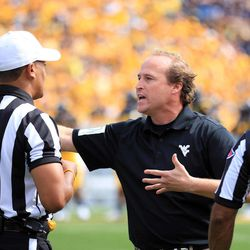 West Virginia coach Dana Holgorsen discuss a call with officals during their NCAA college football game against Baylor in Morgantown, W.Va., Saturday, Sept. 29, 2012. West Virginia defeated Baylor 70-63.