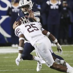 Brigham Young Cougars quarterback Baylor Romney (16) scrambles in Provo on Saturday, Oct. 24, 2020.