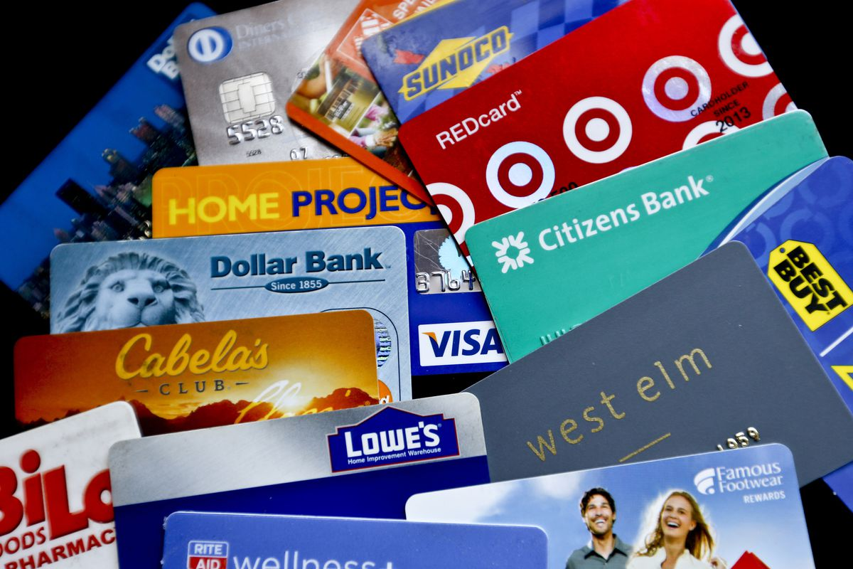 FILE- In this Jan. 31, 2018, file photo, an assortment of credit cards and rewards cards are shown in Zelienople, Pa. Rewards-earning credit cards can help you save on these expenses — but you can also combine those rewards with other money-saving strateg