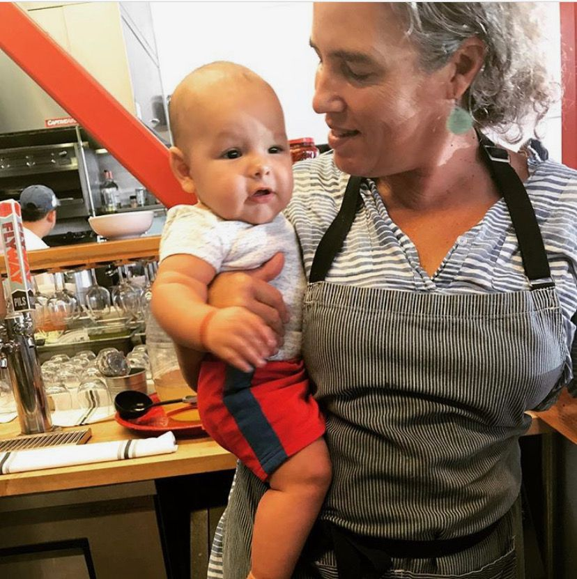Romney Steele at the restaurant with her grandson, Tenoch, on her hip