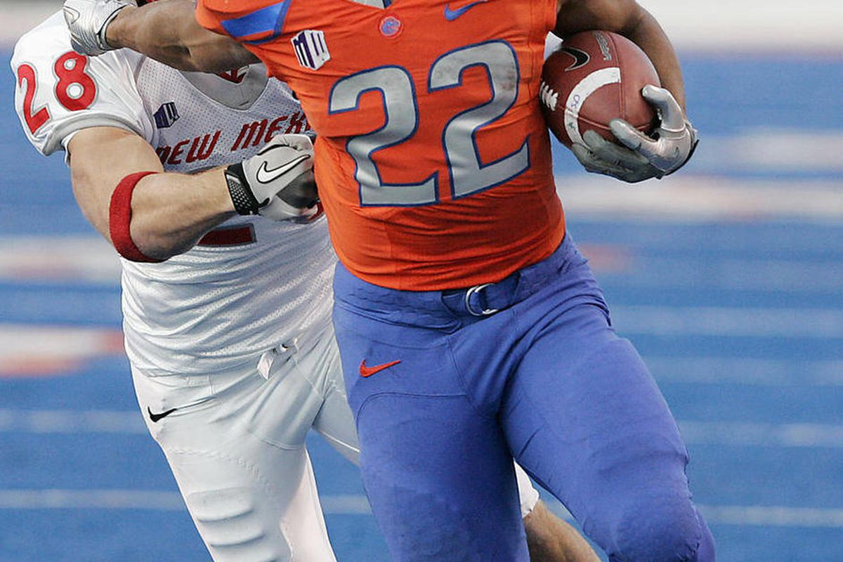 FILE - In this Dec. 3, 2011, file photo, Boise State running back Doug Martin (22) rushes past New Mexico's Bubba Forrest (28) during the first half of an NCAA college football game in Boise, Idaho. Martin was selected as the 31st pick overall by the Tamp