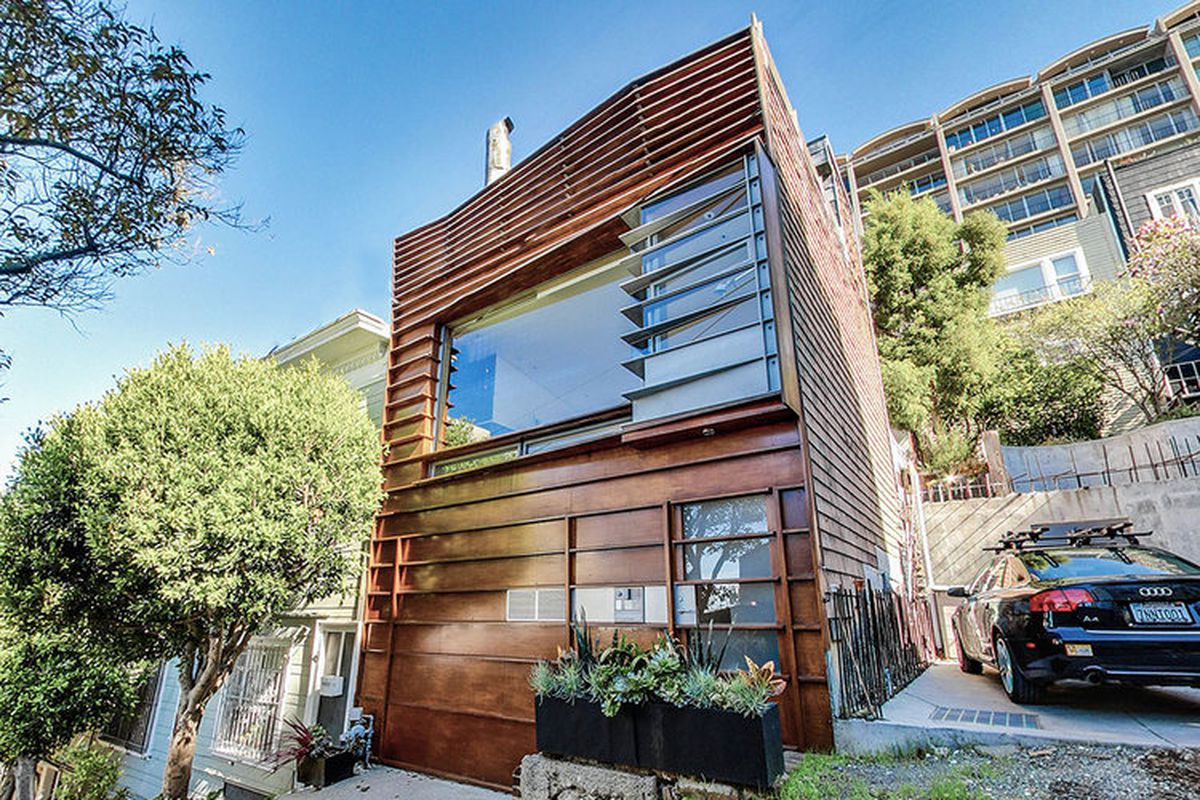 A square house covered in bronze-colored metal siding.