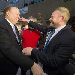 Jim Dabakis and his husband, Stephen Justesen, embrace after being married by Salt Lake City Mayor Ralph Becker as hundreds turn out to obtain marriage licenses Friday, Dec. 20, 2013, in the Salt Lake County offices after a federal judge ruled that Amendment 3, Utah's same-sex marriage ban, is unconstitutional.