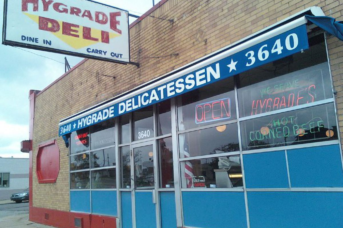 Brick front of Hygrade's Deli building with sign atop