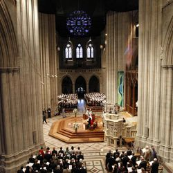 Members of the congregation stand at the Washington National Cathedral in Washington, Thursday, Sept. 13, 2012, during the national memorial service for the first man to walk on the moon, Neil Armstrong.