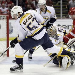 Nashville Predators left wing Gabriel Bourque (57) controls the puck after a deflection by goalie Pekka Rinne during the first period of Game 3 of an NHL hockey Stanley Cup first-round playoff series in Detroit, Sunday, April 15, 2012.