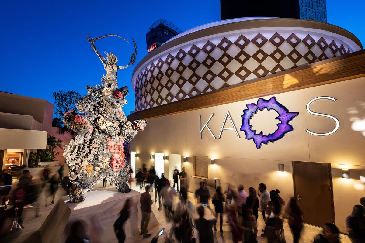 """Damien Hirst's """"Demon with Bowl"""" at the entrance of Kaos"""