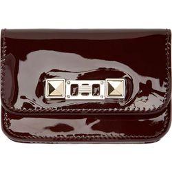 """<b>Proenza Schouler</b> card case, <a href=""""https://www.ssense.com/women/product/proenza_schouler/burgundy-patent-leather-card-case/112948"""">$198</a>"""