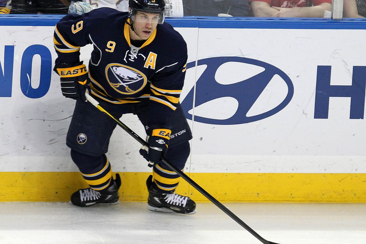 Mar 12, 2012; Buffalo, NY, USA;  Buffalo Sabres center Derek Roy (9) looks to make a pass against the Montreal Canadiens at the First Niagara Center.  Mandatory Credit: Timothy T. Ludwig-US PRESSWIRE