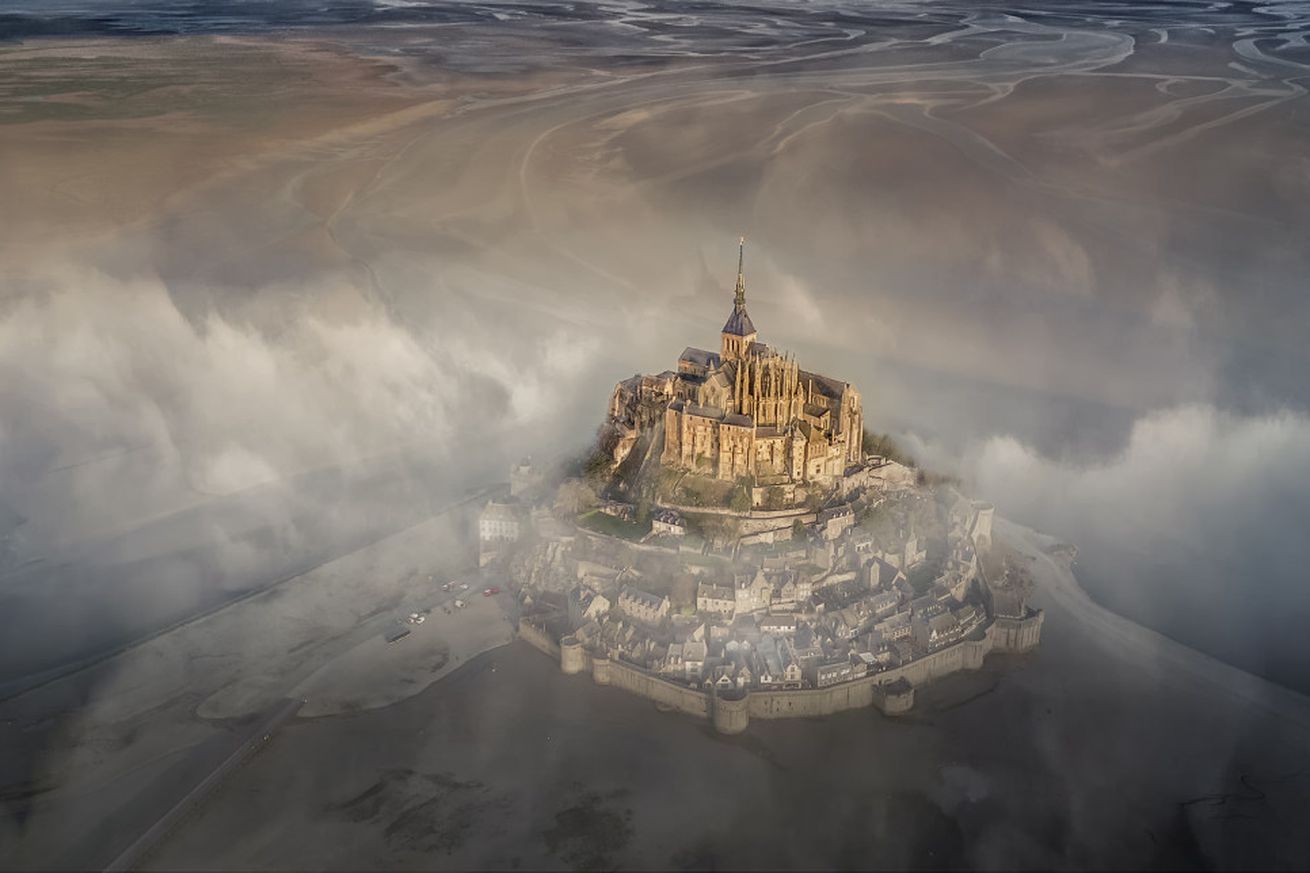 """<em>""""The famous monastery of Mont Saint Michel during a foggy morning.""""</em>"""