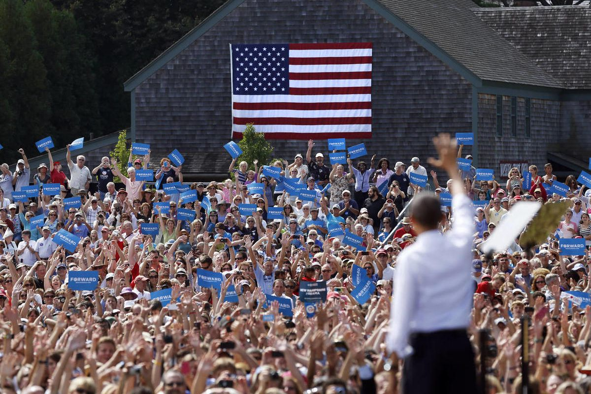 President Barack Obama waves to the crowd at a campaign event at Strawbery Banke Museum in Portsmouth, N.H., Friday, Sept. 7, 2012.