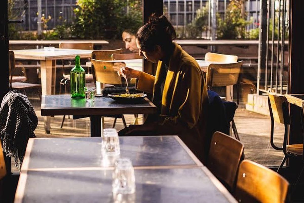 A solo diner enjoys pasta at Ombra
