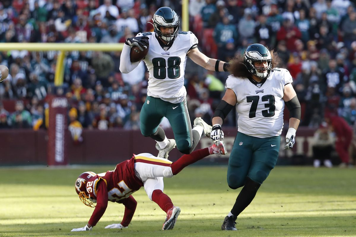 Philadelphia Eagles tight end Dallas Goedert leaps over Washington Redskins cornerback Jimmy Moreland while running with the ball in the second quarter at FedExField