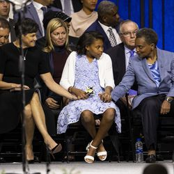 Mayor Lori Lightfoot whispers something to her daughter, Vivian, and wife, Amy Eshleman, during the city of Chicago's inauguration ceremony at Wintrust Arena, Monday morning, May 20, 2019.