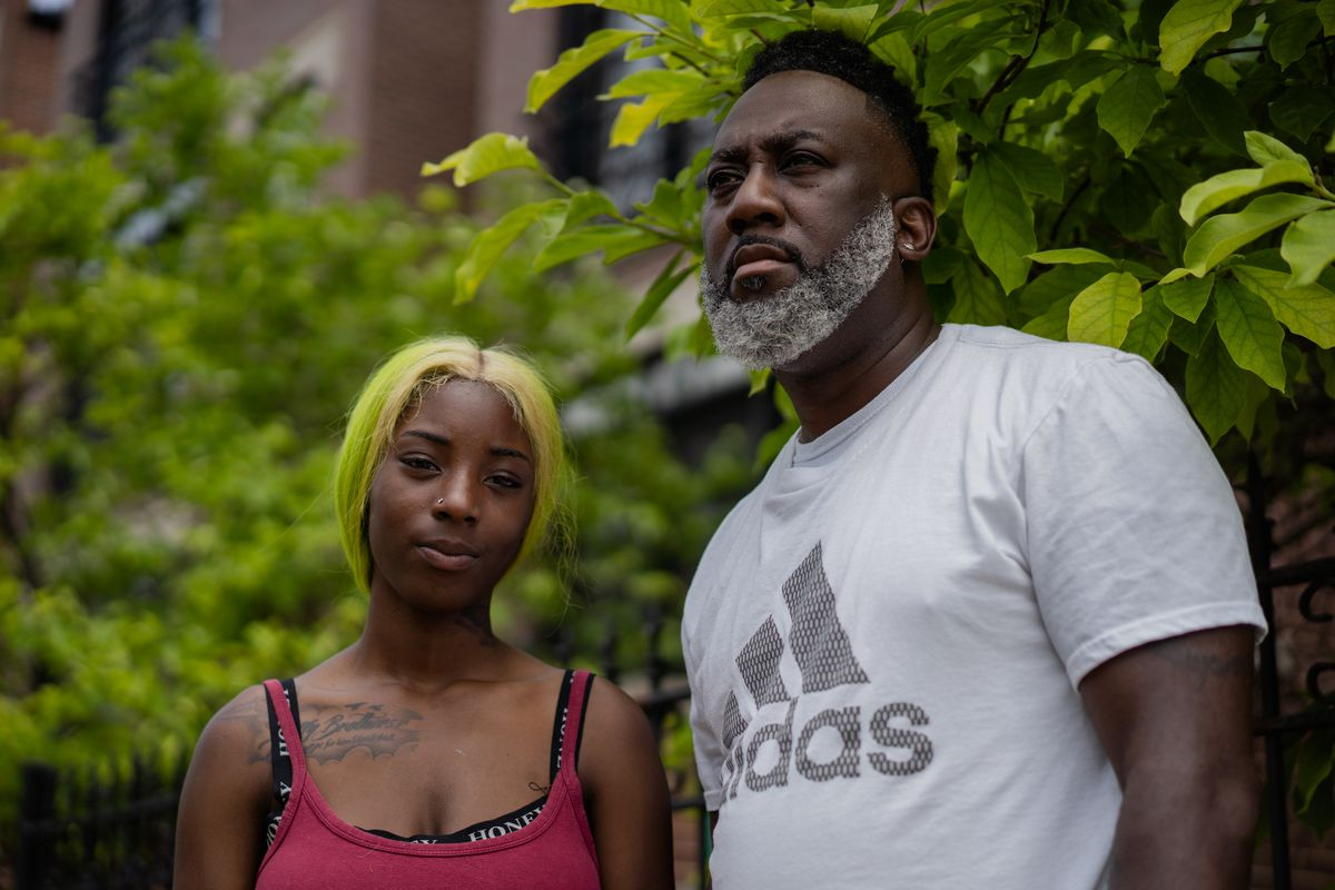 Single dad Laurentio Howard and his daughter, Dnigma Howard, 18, stand outside their Near North Side home on Saturday, June 20, 2020. Dnigma was 16 when she was shoved down the stairs and Tased by Chicago police officers stationed within Marshall Metropolitan High School in a January 2019 incident that drew national headlines. She recently graduated from her CPS school.