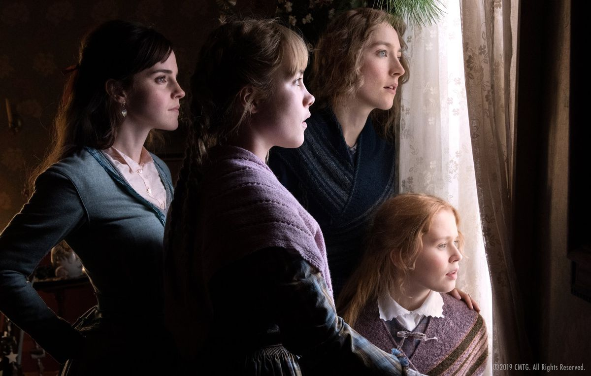 The four March sisters look out the window.