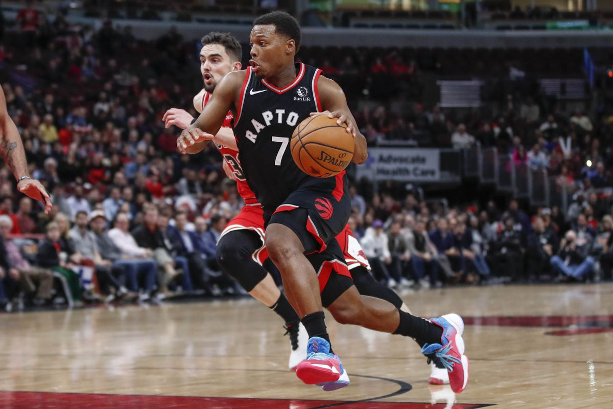 Toronto Raptors guard Kyle Lowry drives to the basket past Chicago Bulls guard Tomas Satoransky during the second half at United Center.