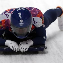 Elizabeth Yarnold of Great Britain brakes in the finish area during the women's skeleton competition at the 2014 Winter Olympics, Friday, Feb. 14, 2014, in Krasnaya Polyana, Russia.