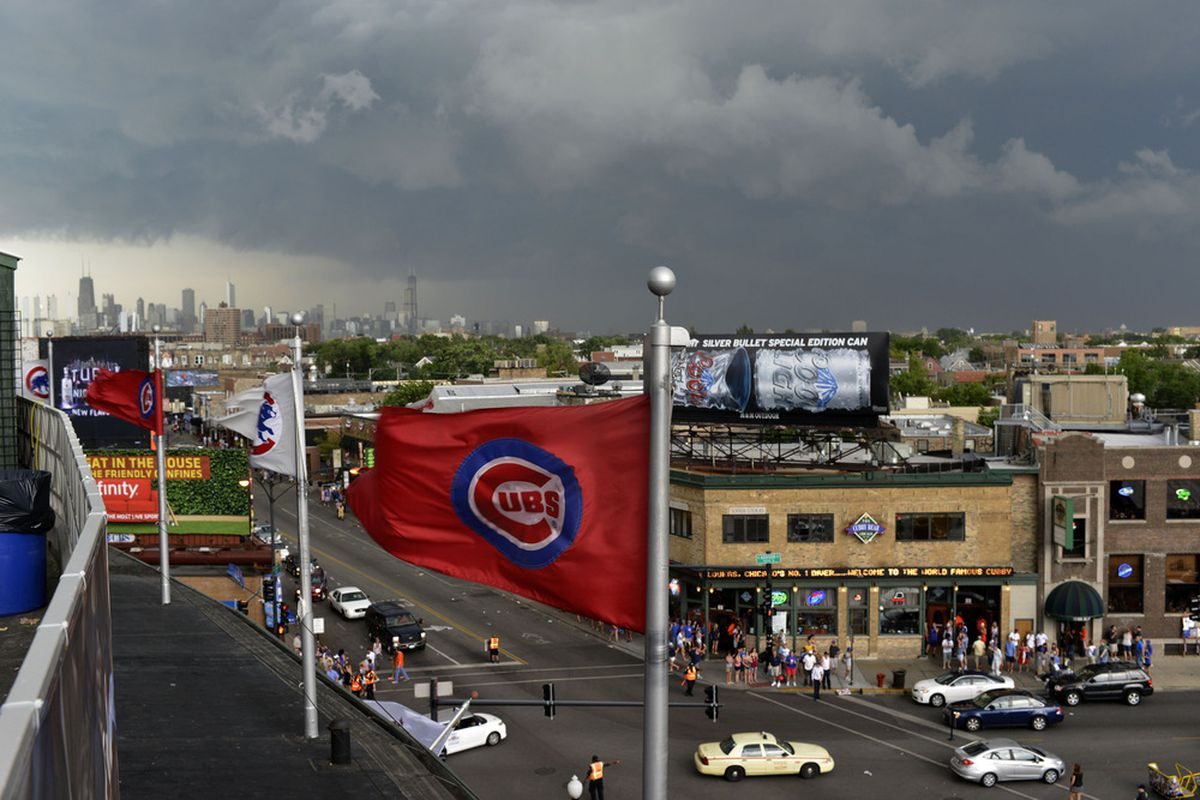 Storm clouds cover the sky above Wrigley Field before the start of the game on Sunday between the Chicago Cubs and Houston Astros in Chicago, Illinois.  (Photo by Brian Kersey/Getty Images)