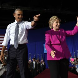President Barack Obama and Democratic presidential candidate Hillary Clinton arrive at a campaign stop at the Charlotte Convention Center in Charlotte, N.C., on Tuesday, July 5, 2016. Obama spent the afternoon campaigning for Clinton.