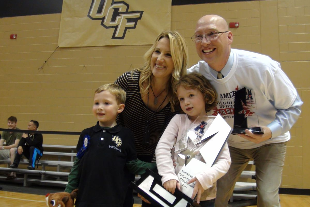 UCF Volleyball head coach Todd Dagenais, accompanied by his family, celebrate the Knights' 2014 American Athletic Conference Championship at the Venue. (Photo: Jeff Sharon)