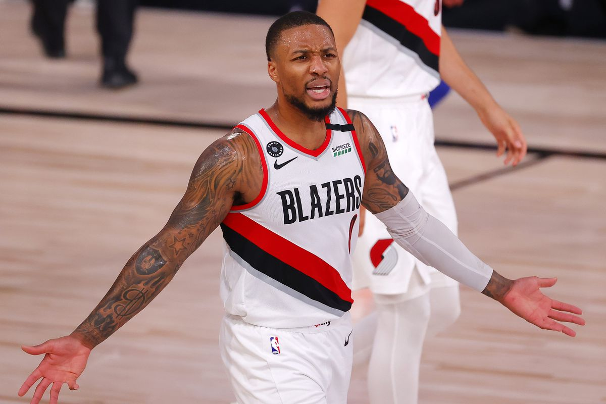 Damian Lillard of the Portland Trail Blazers reacts to an official against the Philadelphia 76ers during the second quarter at Visa Athletic Center at ESPN Wide World Of Sports Complex on August 09, 2020 in Lake Buena Vista, Florida.