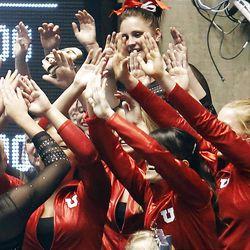Utah's team cheers for Kailah Delaney after her vault at the NCAA Salt Lake Regional Gymnastics Saturday, April 7, 2012 in Salt Lake City.