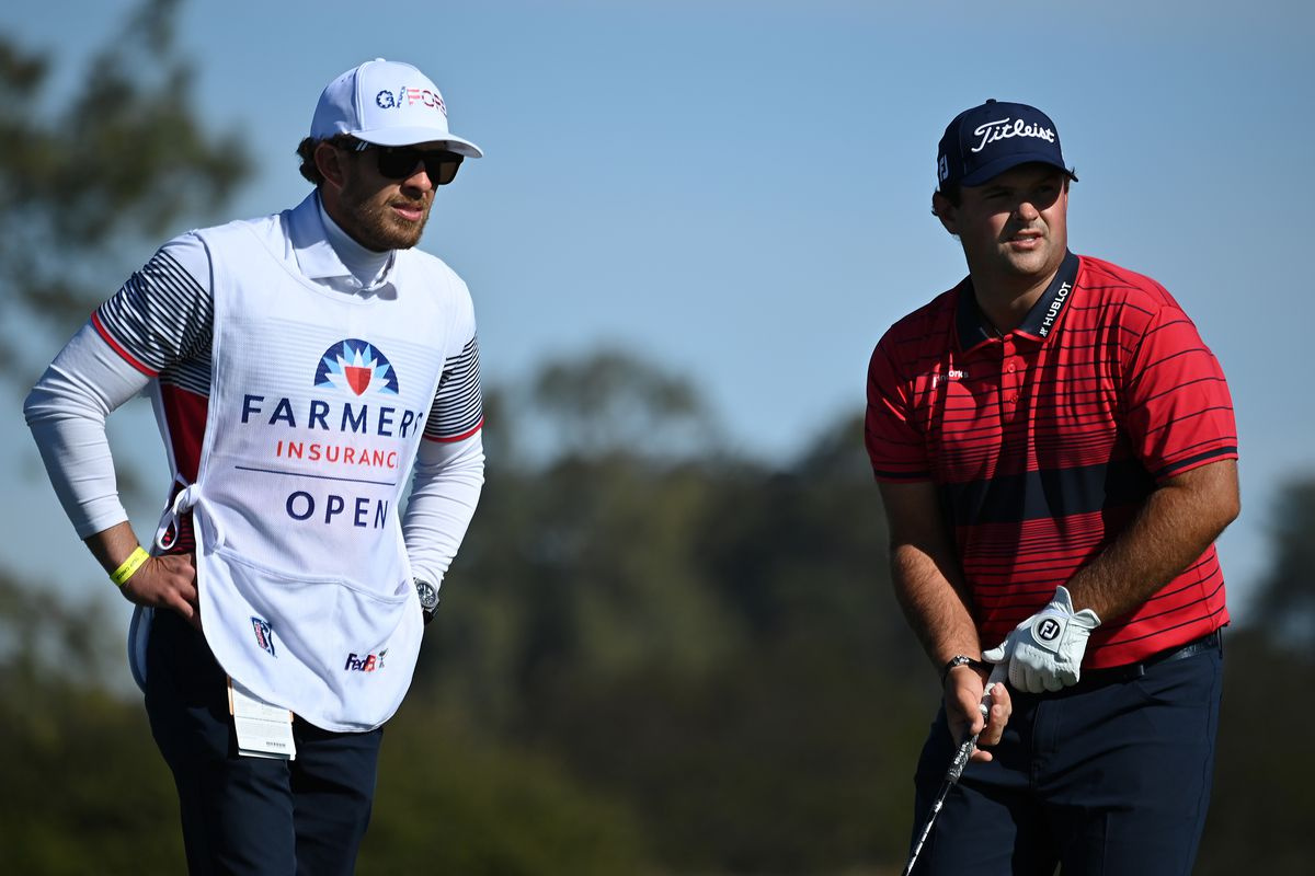 Patrick Reed stands with his caddie on the 2nd hole tee during the final round of the Farmers Insurance Open at Torrey Pines South on January 31, 2021 in San Diego, California.