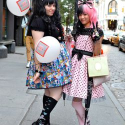 Carla and Yuki at Mercer and W. Houston. They said everything they're wearing is of their own design.