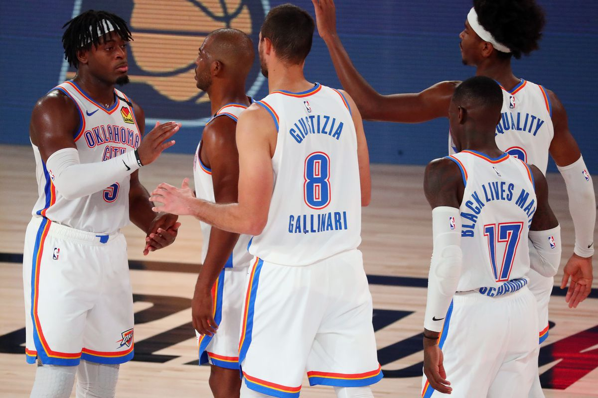 Luguentz Dort celebrates with Chris Paul, Danilo Gallinari, Dennis Schroder, and Shai Gilgeous-Alexander celebrate after defeating the Houston Rockets in game four of the first round of the 2020 NBA Playoffs at AdventHealth Arena at ESPN Wide World Of Sports Complex on August 24, 2020 in Lake Buena Vista, Florida.