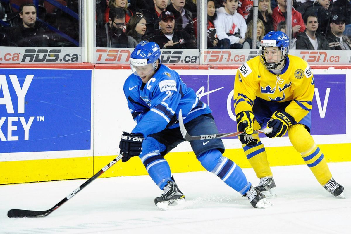 Pictured here: Mikael Granlund of Team Sweden chases down some guy in a blue jersey.