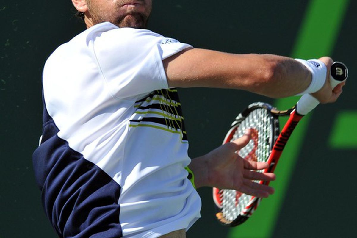 March 29, 2012; Key Biscayne, FL, USA:  Mardy Fish (USA) returns a shot back to Juan Monaco (ARG) at the Sony Ericsson Open. Mandatory Credit: Photo by Steve Mitchell-US PRESSWIRE