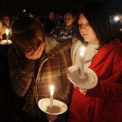 Stromee Ryan and Shayanna Smith along with Powell family friends and well wishers hold a candlelight vigil in Salt Lake County  Sunday, Feb. 5, 2012. Josh Powell and his two sons were killed in an explosion in Washington.