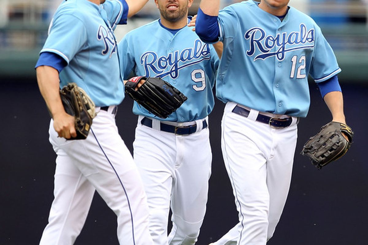 aaa6a47c230 Outfielders Scott Podsednik, David DeJesus, and Mitch Maier of the Kansas  City Royals celebrate after the Royals defeated the Cleveland Indians 6-4 to  win ...