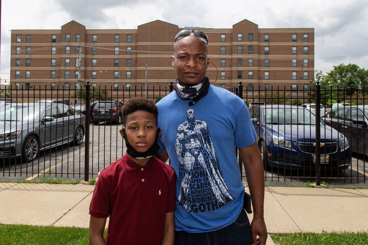 Erik Miles Jr., 8, and his dad Erik Miles Sr. after a demonstration on West 79th Street and South Racine Avenue in Auburn Gresham on Thursday.