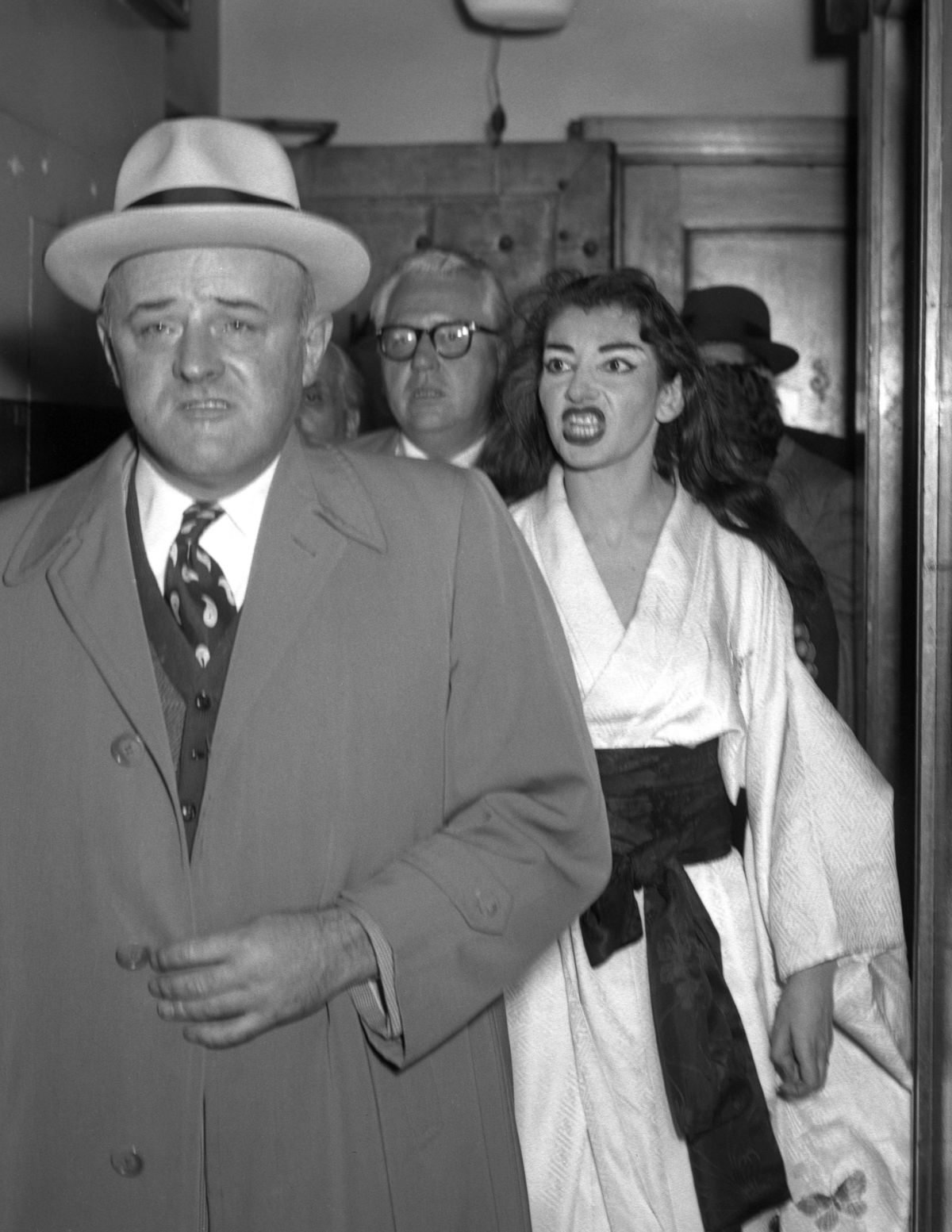 """Opera diva Maria Callas hisses at federal marshal Stanley Pringle, who served a summons to her following her performance in """"Madame Butterfly"""" at the Chicago's Civic Opera House in 1955. Callas was being sued by a management firm."""